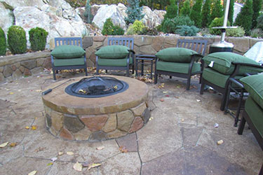 round cobblestone fire pit for the backyard
