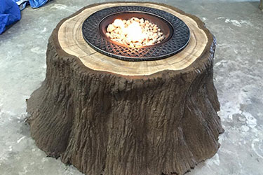 natural brown outdoor gas tree stump fire pit in Madison Wisconsin