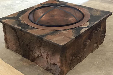 square copper and stone fire pit in Wisconsin