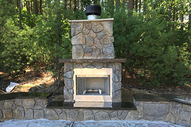 medium sized natural wood burning outdoor fireplace in Madison Wisconsin