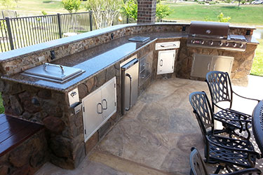 Outdoor Kitchen with Bar and Grill for backyards in Madison Wisconsin