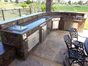 Outdoor kitchin with grill and fridge in Madison WI