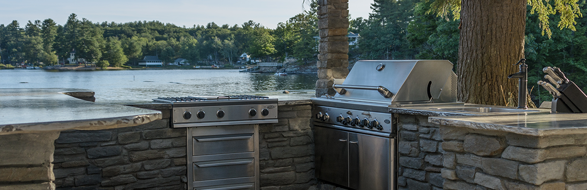 Stone Outdoor Kitchen With Grill And Sink In Madison, WI